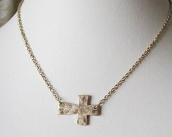 Antique Gold Finish Sideways Hammered Cross Necklace