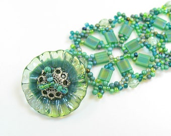 Woven Green Bracelet with Lampwork Disk Bead Clasp