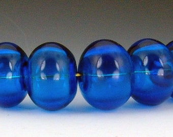 Set of 5 Handmade Lampwork Hollow beads in deep aqua blue