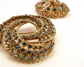Two vintage rhinestone brooches / goldtone / blue green topaz