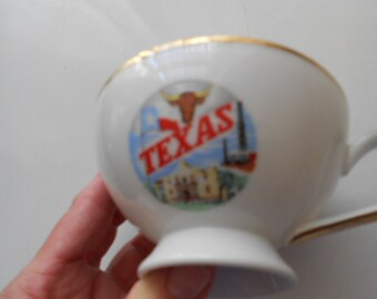 Vintage Porcelain Cup says Texas on the front Marked Made in Japan on the bottom