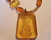 Carved Kwan Yin Pendant and Amber Beads
