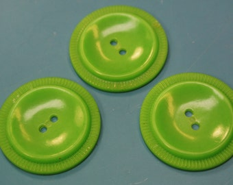 Lot of 3 larger vintage 1950s unused light grass green plastic buttons for your sewing prodjects