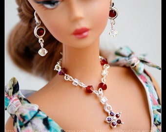 Beautiful Y Necklace with Red Swarovski Crystal and Crystal Flower shaped Pendant.