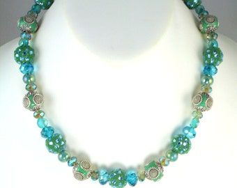 Summer in the City, handmade necklace of various size Chinese crystal and 12mm round, blue green beads with crystals and metal accents