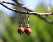 Antiqued brass earrings with red jasper creek round beads