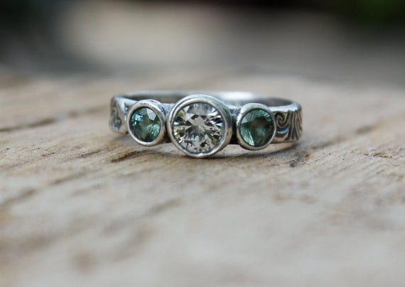 ethical three sapphire wedding band engagement ring . fair trade green sapphire ring . recycled silver white sapphire ring by peacesofindigo