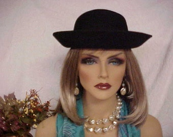 Black wool felt- derby or cloche hat- wear brim up or down- has velvet band- fits 21-22 inches