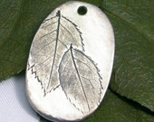 Jewlery Designers treasure leaf charms or pendants made from real leaves