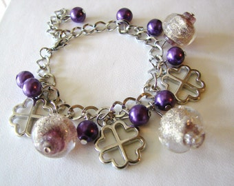 Pretty silver charm bracelet with purple and glittery glass accent beads