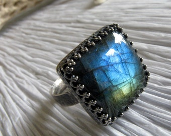 Labradorite square gemstone ring.  Rustic oxidized sterling silver setting. 18.4 carats. Striking blue flash quality. Textured band. Size 9