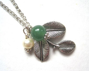 Three-leaf  silver pendant and wth green jade and pearl beads on a necklace.