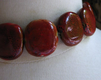 Maroon with Black Speckles Ceramic Oval 25mm by 30mm by 9mm 1pc