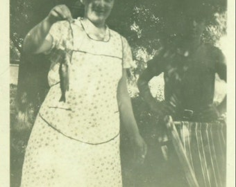 Catch of the Day Woman in Apron Holding Very Small Fish Fishing Vintage Photo Black and White Photograph