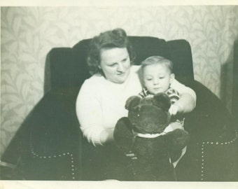 Happy Tot Playing With a Teddy Bear Little Boy and Woman Sitting in A Big Chair 1930s  Black and White Vintage Photo Photograph