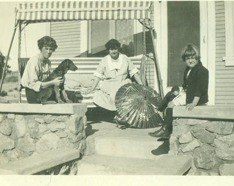 1920s Women Sitting on Front Porch With Dog Parasol Sun Umbrella Girl Vintage Black and White Photo Photograph