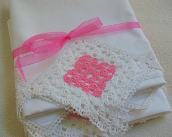 Vintage lace trimmed set of pillowcases Lavishly embellished with Crocheted lace insets Graced with a dollop of pink lace Bridal linen