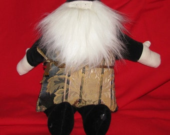 Black and gold stuffed Santa with music box