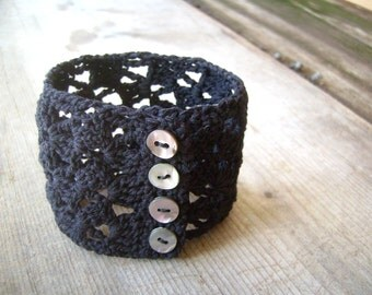 Black crocheted cuff with vintage mother of pearl buttons. Lace bracelet. Crocheted jewel