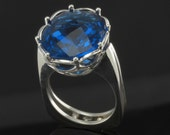Sterling Silver Ring set with oval checkerboard cut London Blue Topaz