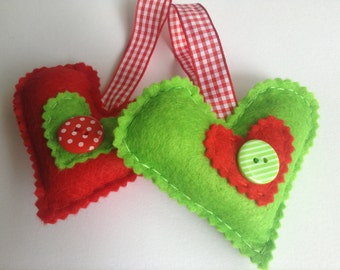 Two pack of handmade felt Christmas decorations in red and green contrasting colours