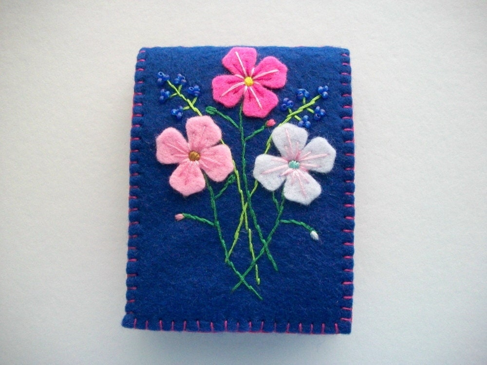 Blue needle book with hand embroidered felt flowers sewn
