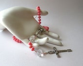 Small, Bright Pink Rosary in Rhodochrosite with Scapular Center and Risen Christ