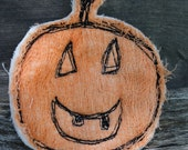 Halloween inspired Fiber Art jack o lantern brooch