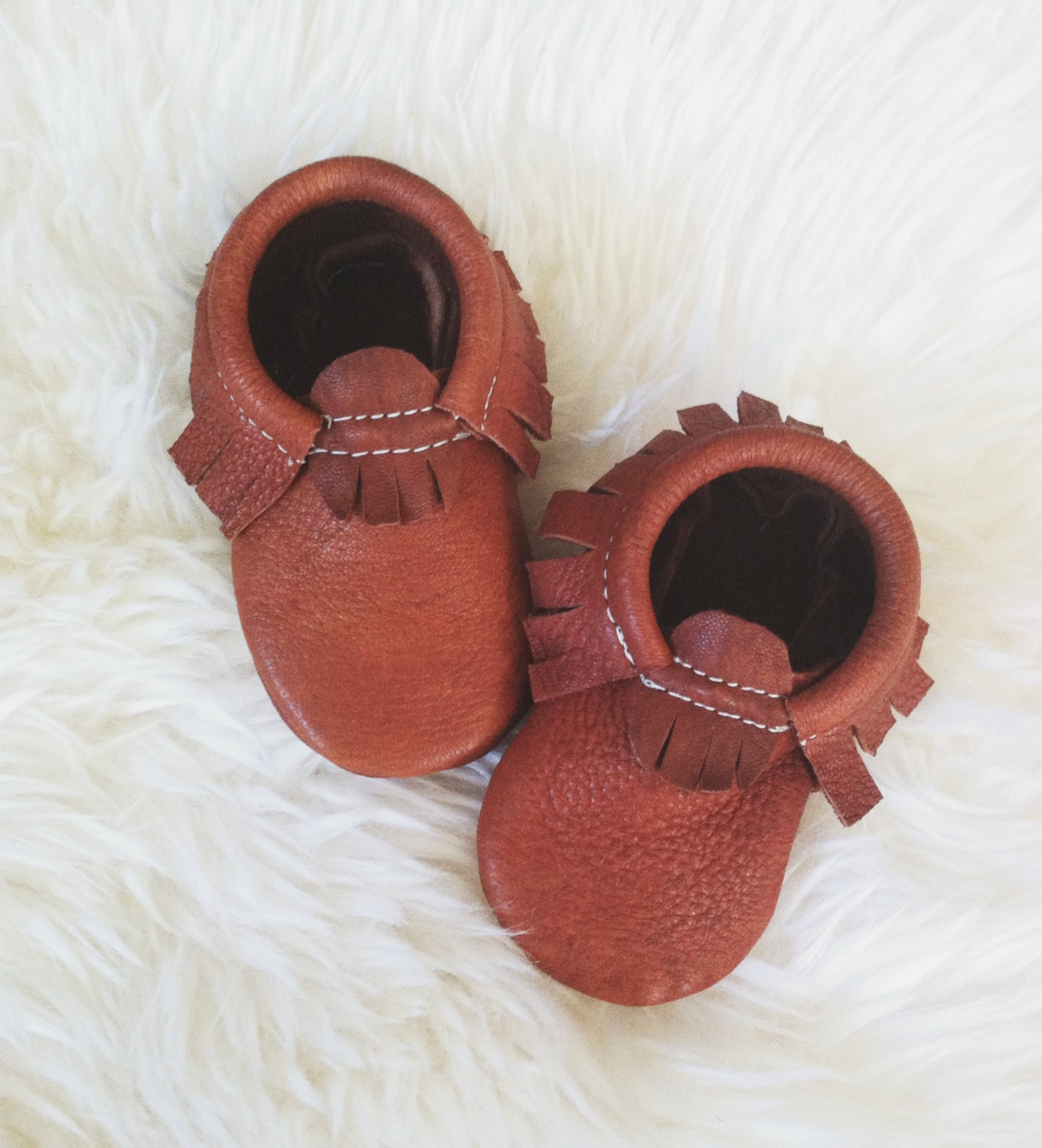 At Freshly Picked, we design unique, premium and useful products for families. Our classic diaper bag, soft-sole baby moccasins, and kids' sneakers are made to be durable, functional, and look amazing. Our purpose is to provide families with product and inspiration .