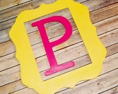 "Funky shaped frame and 12"" wooden letter Painted to match your decor"