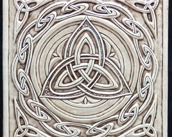 Relief carved Celtic trinity ceramic tile