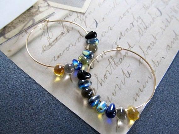 Gold beaded hoop earrings, small glass teardrops in the center