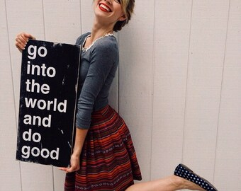 go into the world and do good - Distressed Sign in Black with White Vintage Style