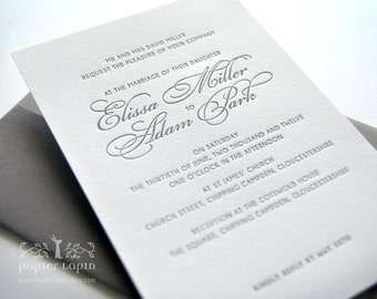 Love note: Letterpress invitation, superior quality cotton paper, nice to the touch, earth friendly, classy grey and white. What a classic!