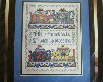 Bucilla Collectable Teapots counted cross stitch kit. While the pot boils, friendship blossoms. Joan Elliot