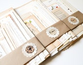 Vintage Paper Assortment including french text, recipes, music, dictionary, and children's books