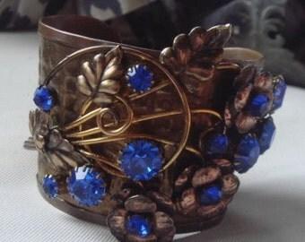 Vintage Brass Art Nouveau Cuff. Swarvoski cobalt blue stones. Gold overlay Sterling. Great detail !