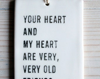 porcelain tag screenprinted text your heart and my heart are very, very old friends. -hafiz