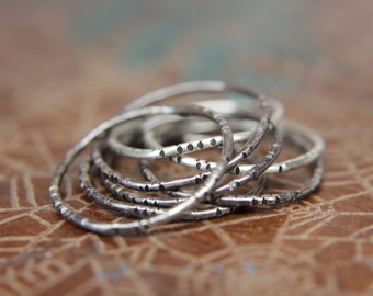 RESERVED FOR HAILEY- two rings...Textured wobble rings set.                                   Seven sterling silver organic stacking rings.