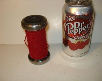 Vintage Colorful Industrial Spindle with Deep Red Thread