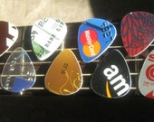 Twenty guitar picks re-purposed from a previous life