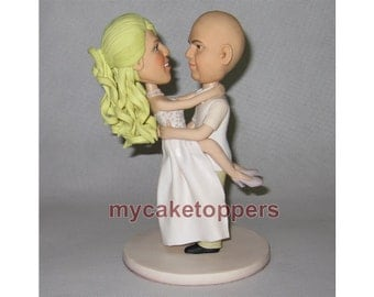 wedding Cake toppers groom carrying bride