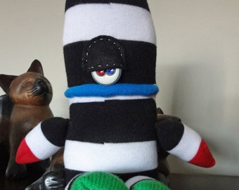 Colossus a happy-go-lucky Ogre of a sOck Monster