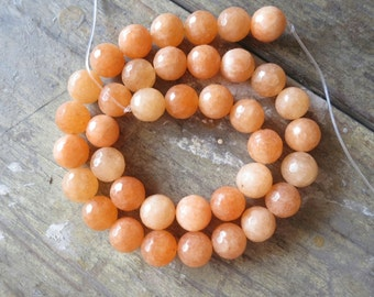 Jade in Light Orange 10mm Faceted round Beads