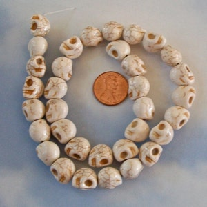 Tiny Cream Colored Howlite Stone Skull Beads Strand