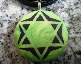 Star of David  hand carved on a polymer clay green pearl color background. Pendant with a FREE necklace