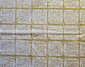 Sheet of white tissue paper handprinted with gold Celtic knotwork linoprint