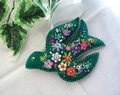 Green felt bird with delux embellishment.