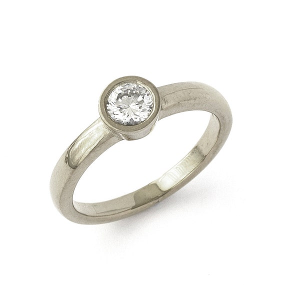 low profile engagement ring in 18k white gold