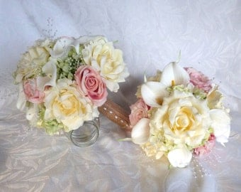 Wedding bouquets and boutonnieres pink blush roses ivory roses white calla lilies green hydrangea